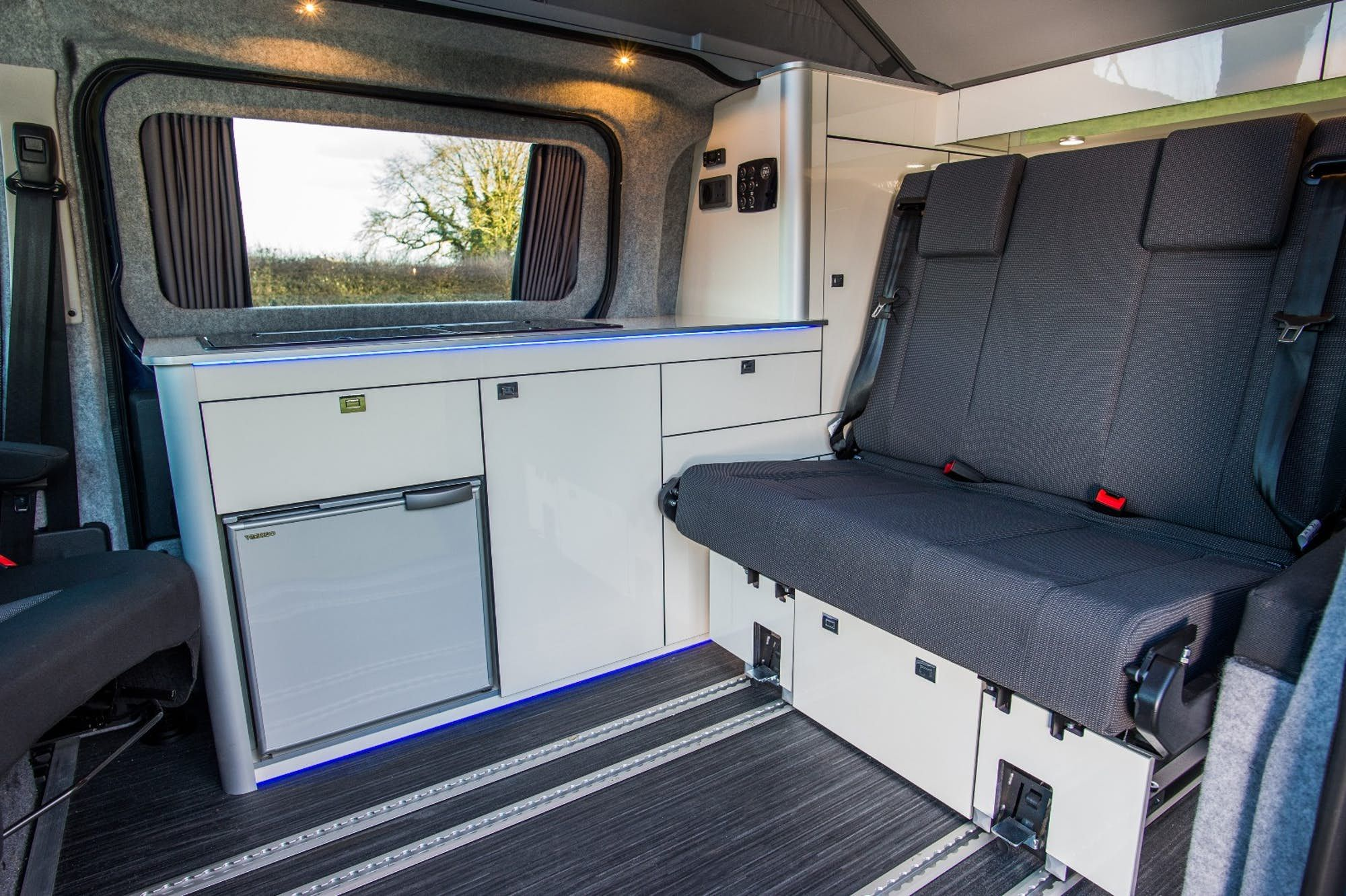 The Interior Uses Floor Rails For Versatile Space Management Camper Interior Toyota Camper Toyota