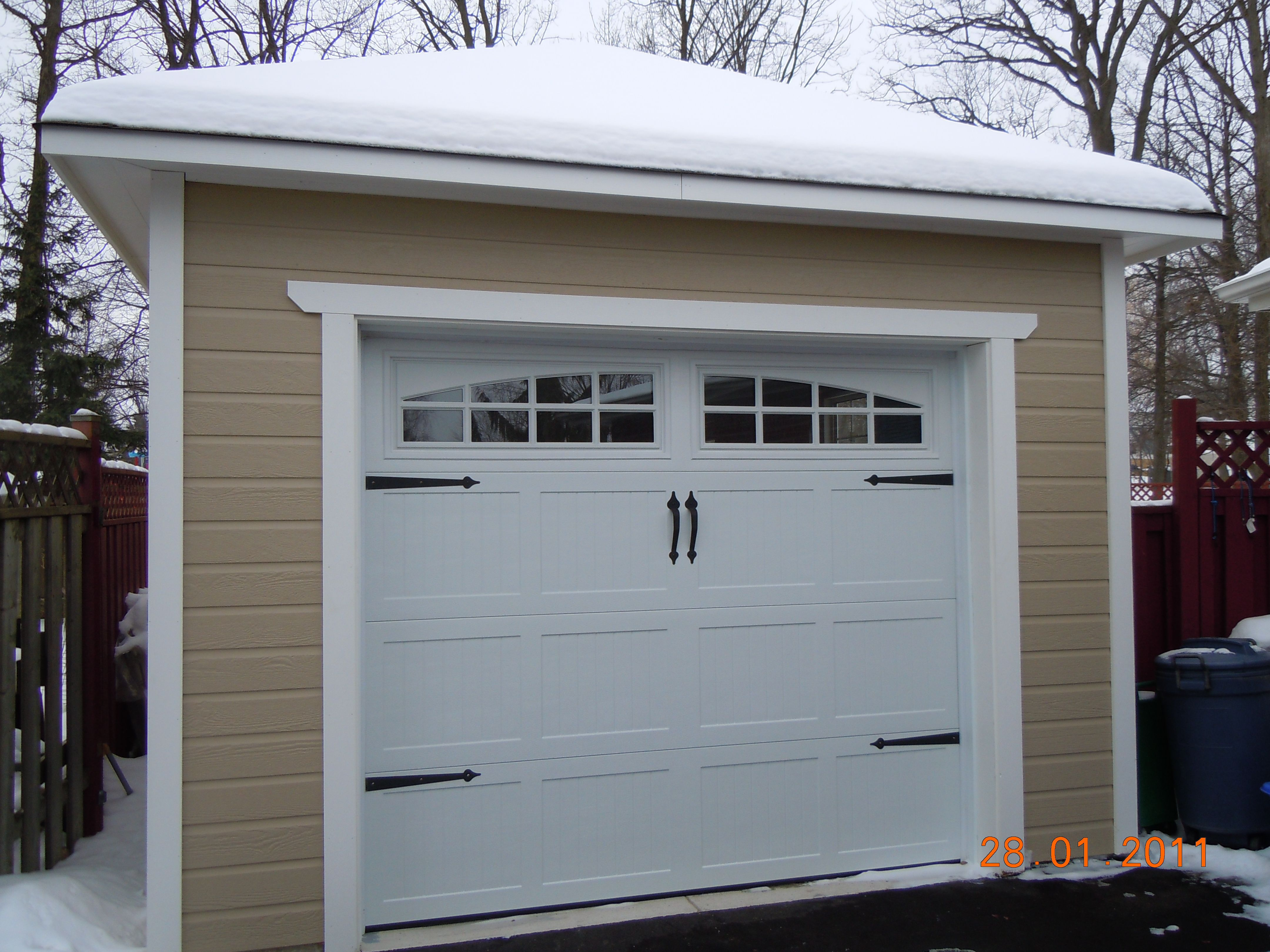 with detail style barn yard garage garages the great overhead newport custom doors burlington ct carriage shingled blog x country roof eyebrow insulated above
