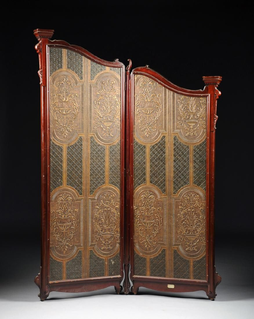 A victorian carved mahogany two panel floor screen lot