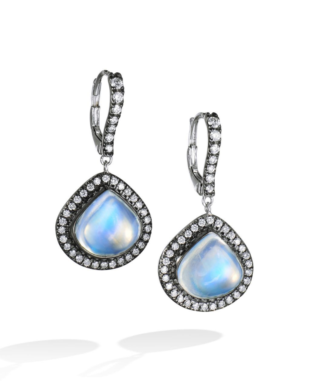 773eee363 18 karat white gold earrings set with 2 pear shaped royal blue moonstone  centers (12.33 CTW) surrounded by round brilliant cut diamonds (0.61 CTW).