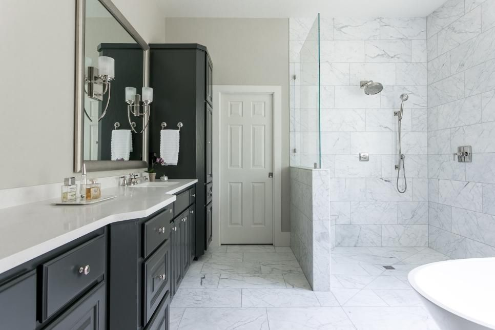 This Master Bathroom Is A Study In Contrasts One Side Of The Room Features An Expansive Bank Of B Modern Master Bathroom Bathroom Shower Design Black Bathroom