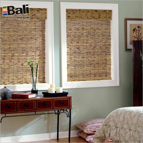 Bali Economy Woven Wood Shades in Cabo Tortoise with Optional Edge Banding in Chestnut. These shades add natural color, texture and dimension to your windows. Available at Blinds.com.