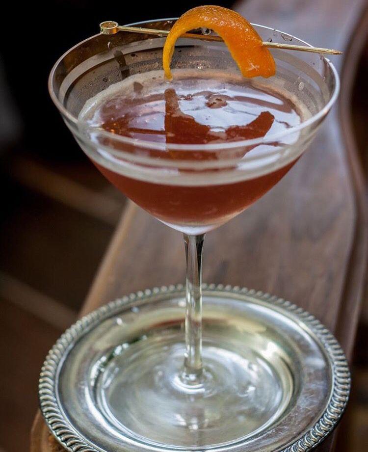 Mae West Coctail: 2oz Cognac, .5 oz lime (half), .5 oz grenadine. Garnish: orange peel.