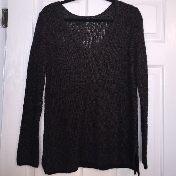 Knitted V-Neck Olive green and black knitted v-neck sweater very soft material never worn!!!!! This is NOT Brandy but I labeled it as Brandy cuz they sell very similar knitted sweaters Brandy Melville Sweaters V-Necks