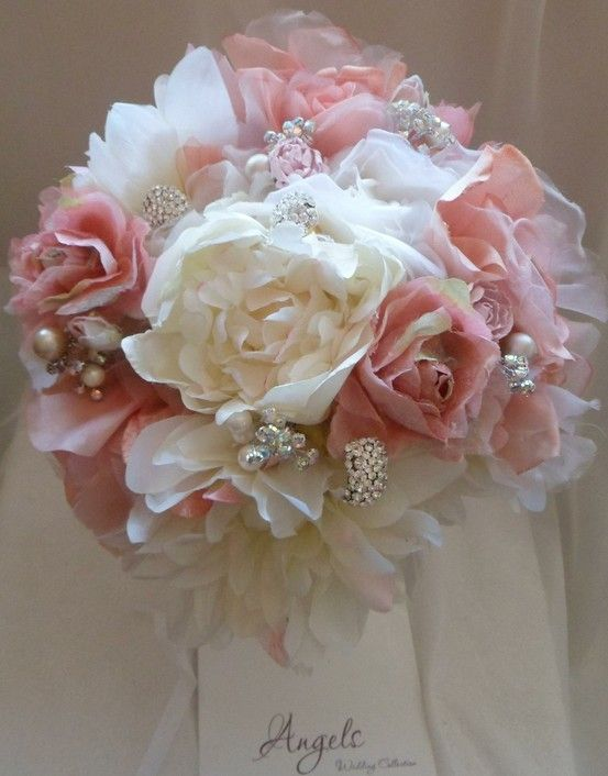 Soft coral and ivory roses and peonies with pearls and brooches  Bridal Bouquet £125.00