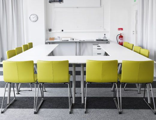 Conference room with green chairs and white tables | Coworking ...