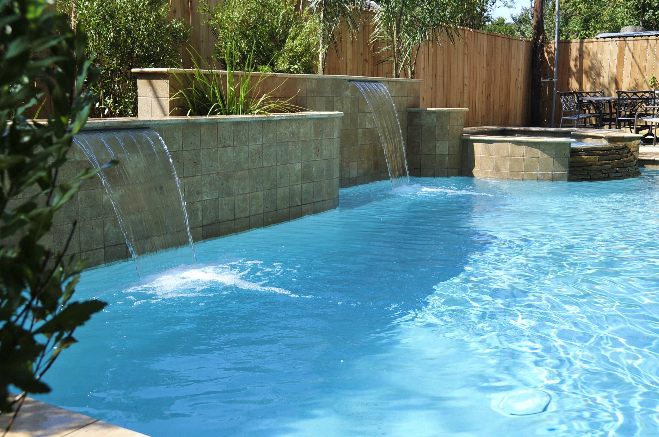 A beautiful backyard pool from Signature Pools of Texas