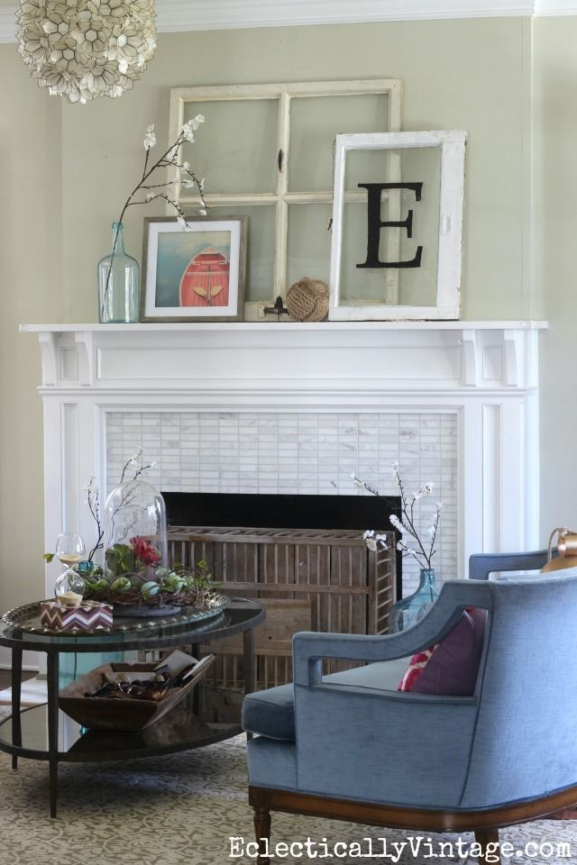Spring mantel - love the old windows combined with boat art and a glass bottle. The the chicken coop fireplace cover is such a fun idea kellyelko.com