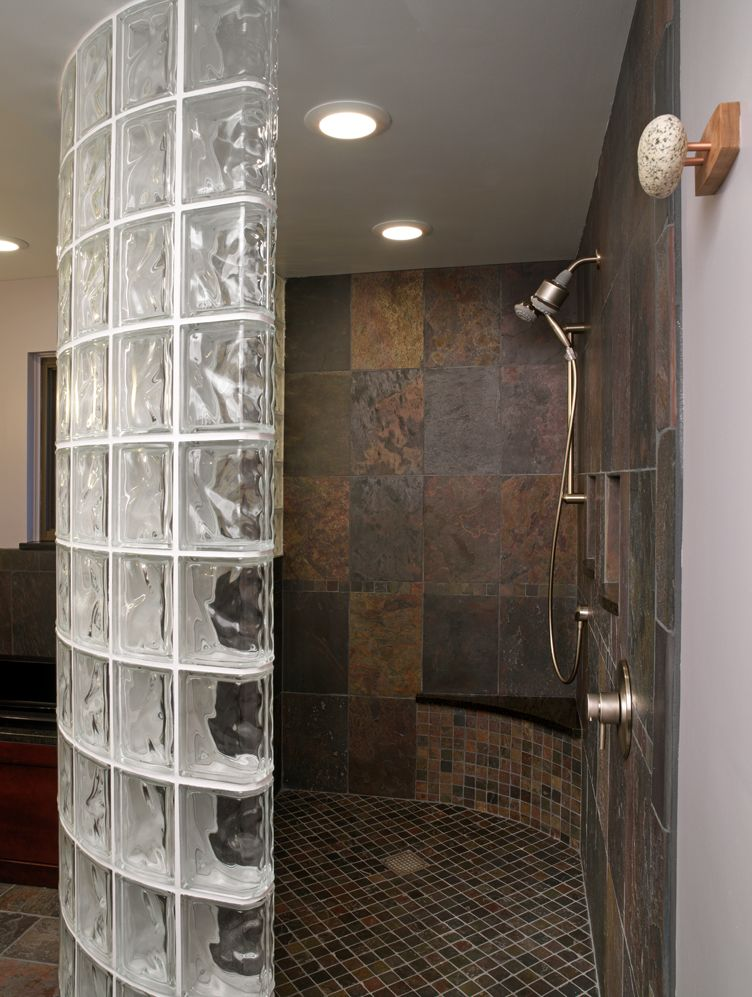 this glass block curved wall was used to create a walk in design with a high level of privacy