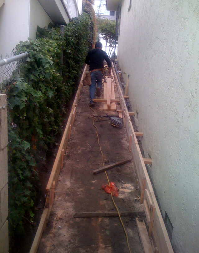 Preparation to pour concrete on a ramp to become a dog-run ...