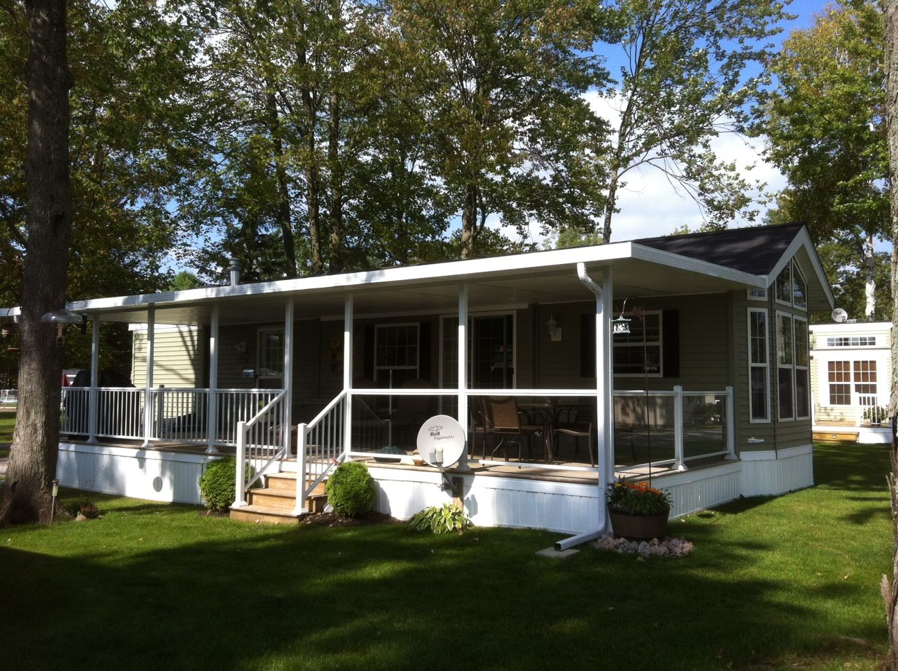 Look At This Sunspace Patio Cover With Glass And Aluminum Picket Railing On  An RV Park