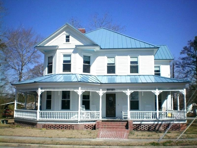 Pictures Of Houses With Blue Metal Roofs Blue Metal Roof Image Of Amazing Blue Metal Roof Blue Metal Roof White Ho Metal Roof Houses Metal Roof Cost House Roof