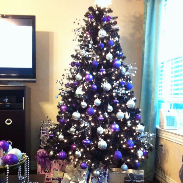 Black Christmas Tree It Makes The Perfect Backdrop For The Gorgeous Purple Ornaments Love Purple Christmas Tree Black Christmas Trees Silver Christmas Tree