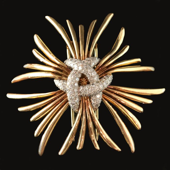 Unusual diamond brooch designed as a cluster of rays joined at the centre by a pavé-set knot motif Verdura, USA circa 1950s