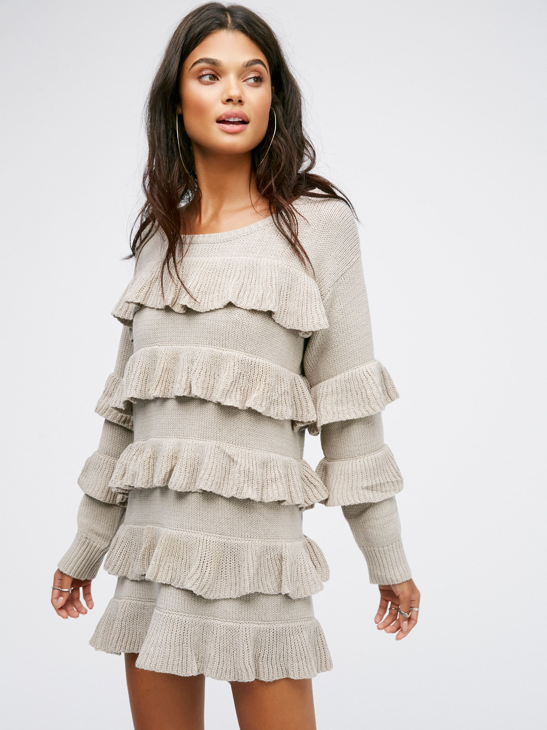 El Dorado Poncho Dress   Long sleeve knit dress with a simple silhouette featuring bold ruffle accents throughout. Ribbed accents at the neckline and sleeve cuffs.