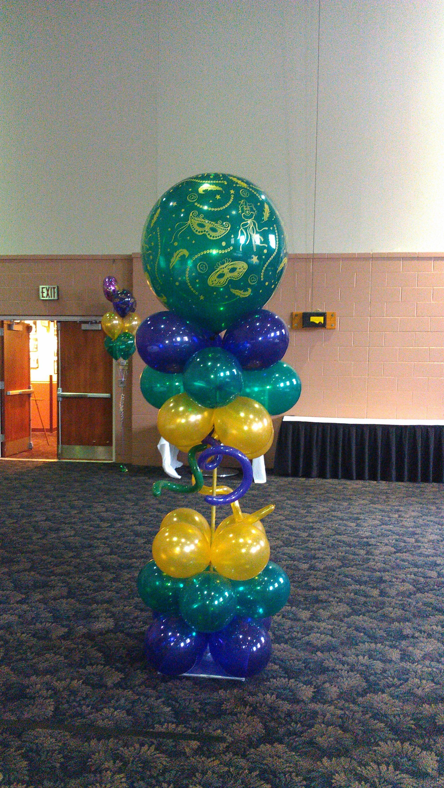Mardi gras balloon column decorations and events