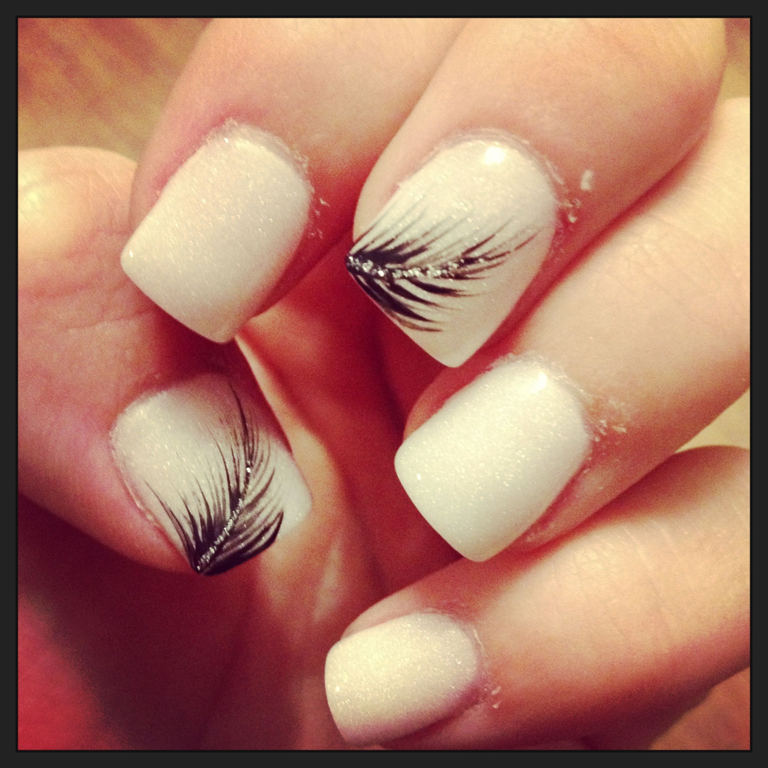 LOVE THIS! def what i wanna get next....Nude nails with feather and ...