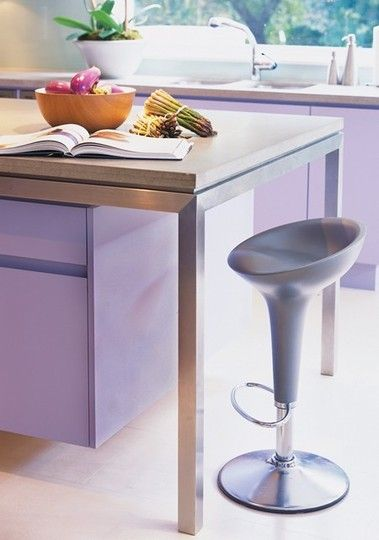 In love with this lavender kitchen.  Would love to see a wooden stool though for some warmth