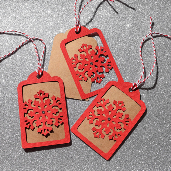 3 snowflake tags per pack. A beautiful way to finish off your holiday wrapping. You choose the colour to match your wrapping papers.  www.heartstringinvitations.com.au