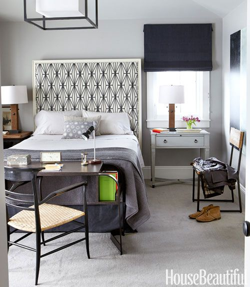 Cool gray walls paint color, tall headboard upholstered in Kelly Wearstler Katana, desk, mismatched nightstands and blue roman shade.