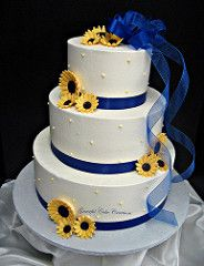 Elegant White Buttercream Wedding Cake with Royal Blue Ribbon and Yellow Daisies