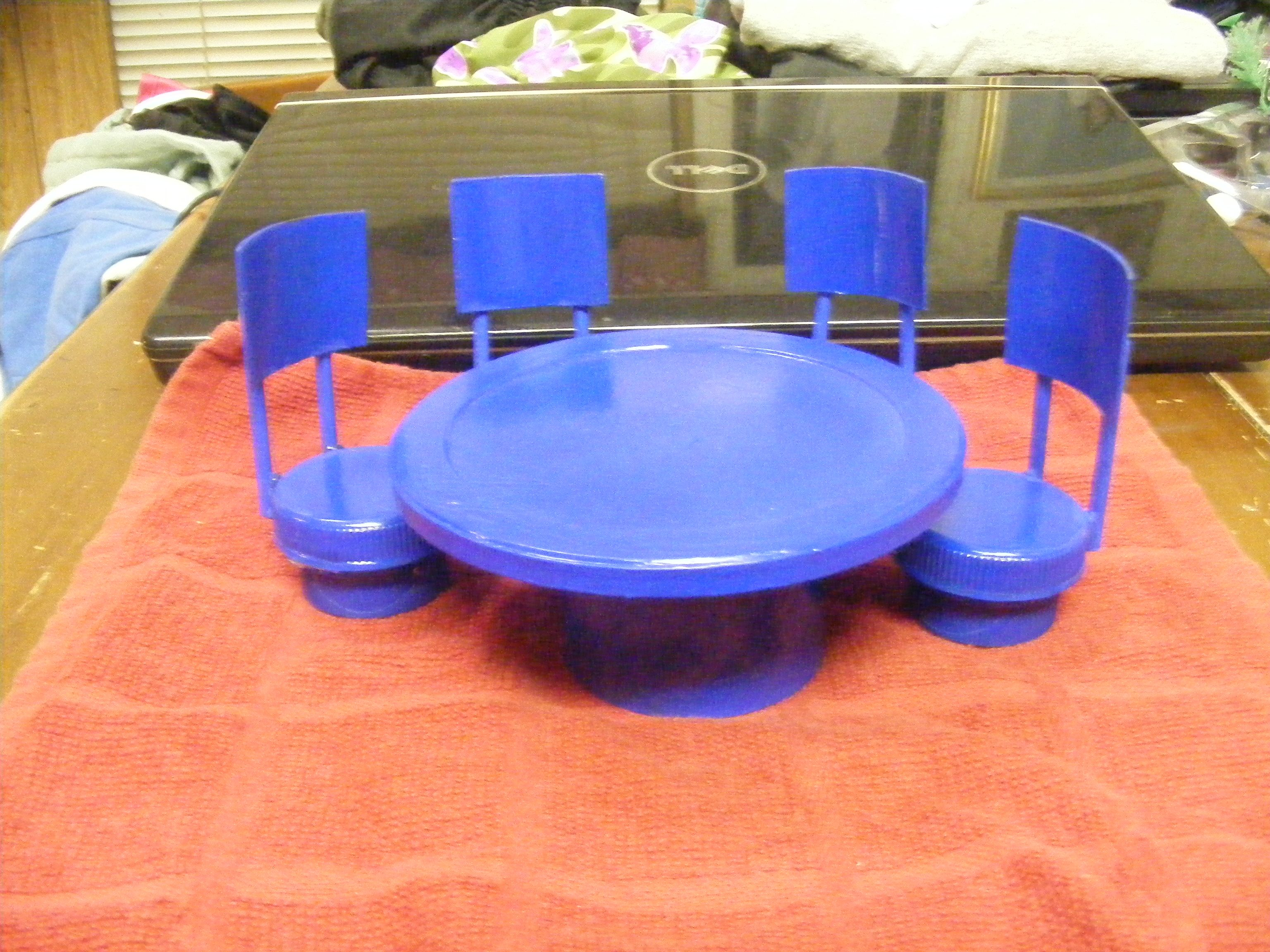 This Set Of Table And Chairs Were Made With Plastic Bottle