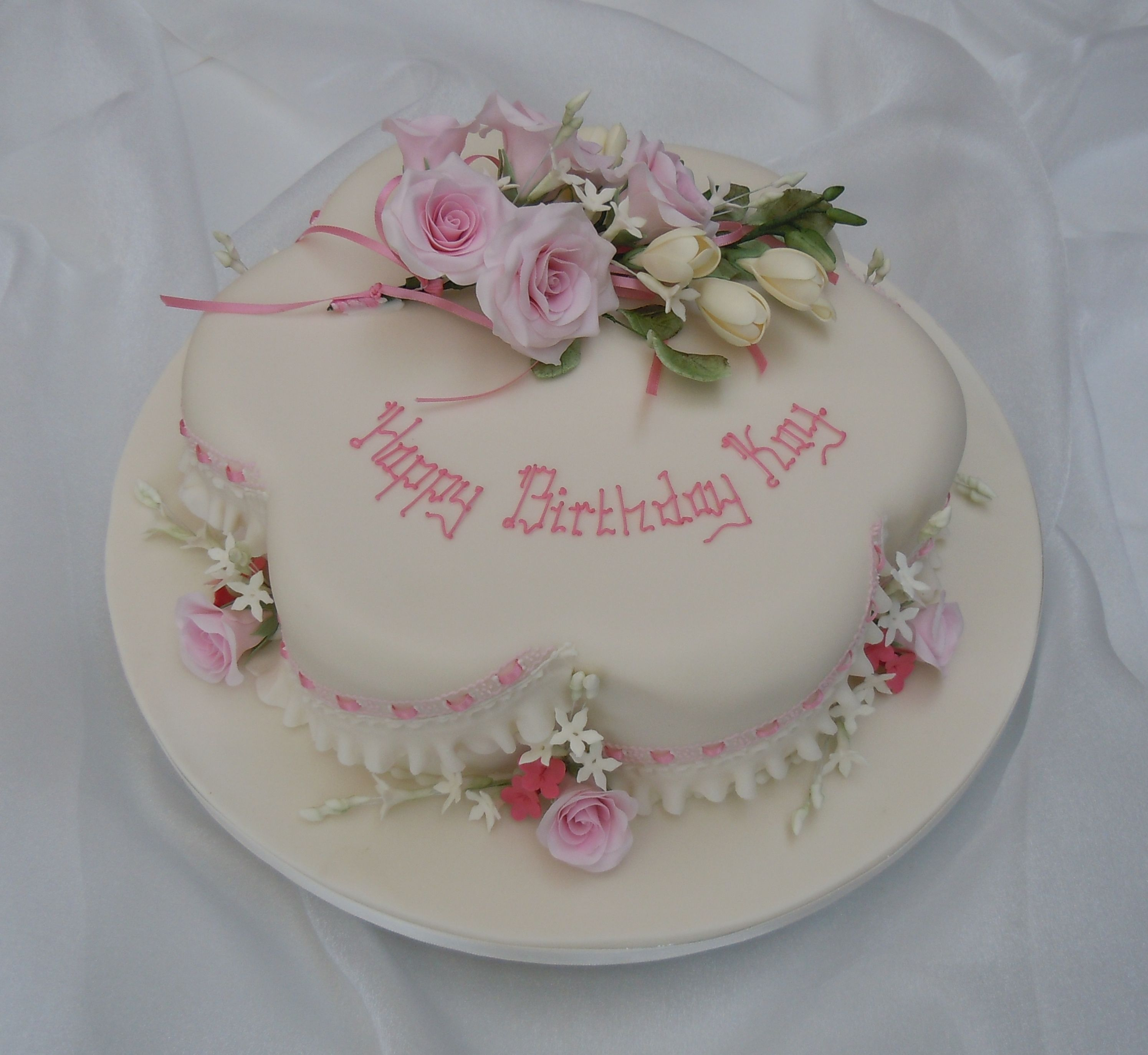 Petal Shaped Birthday Cake With Frill And Ribbon Insertion