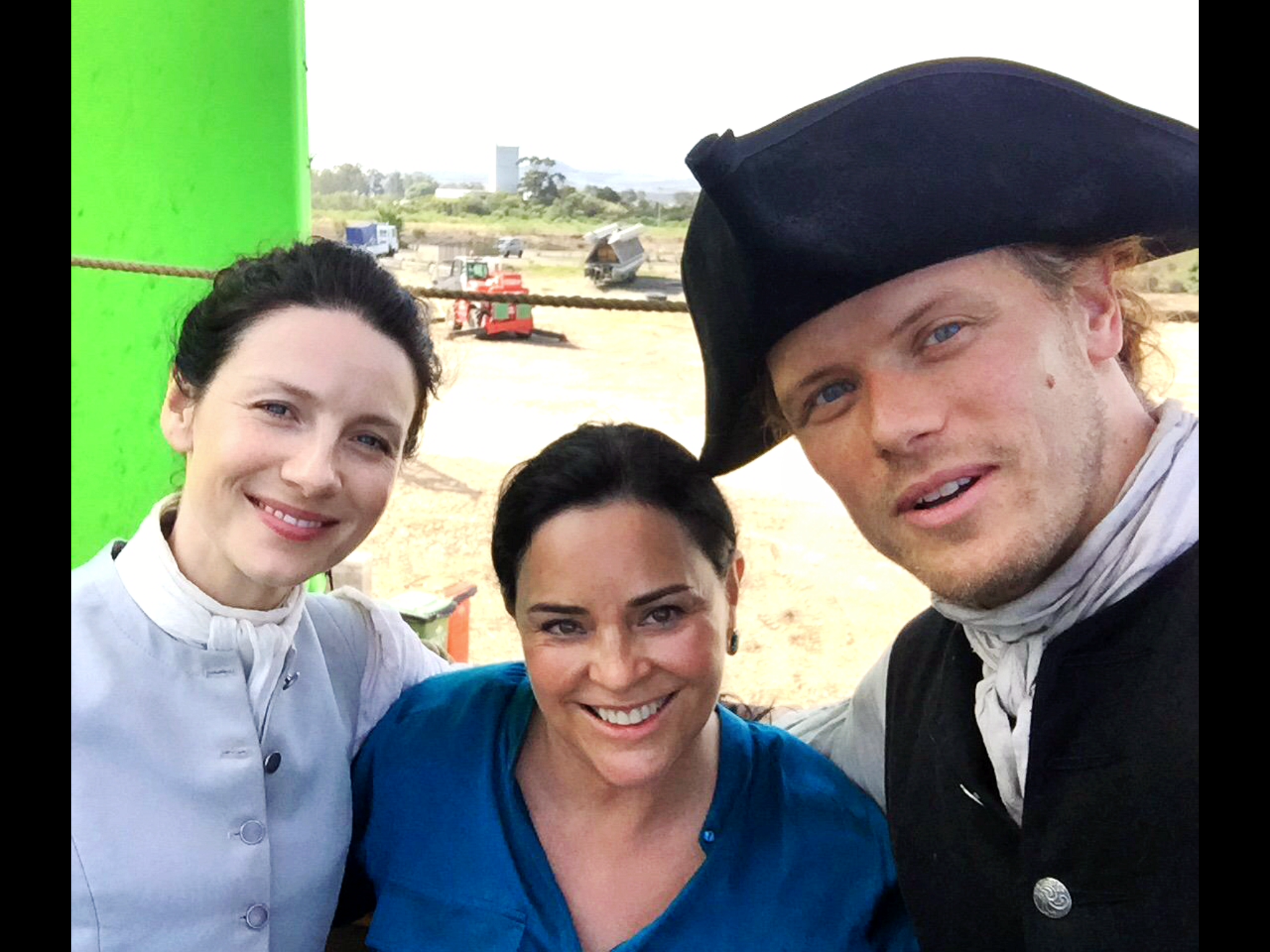Outlander Sam and Cait with Diana Garbaldon on set in SA Source