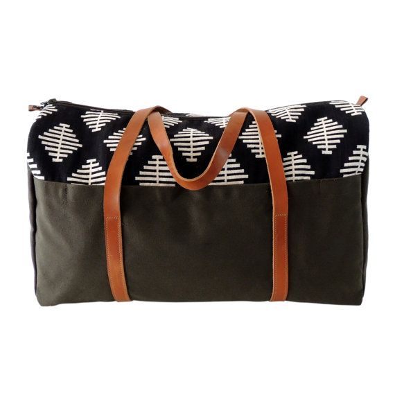 78dc12a452c Let your adventures begin with this classic weekender bag. This large  canvas duffel bag is a great travel companion, with two extra exterior  pockets