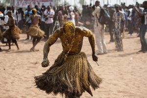 A devotee in a trance performs at the annual voodoo festival in Ouidah, Benin