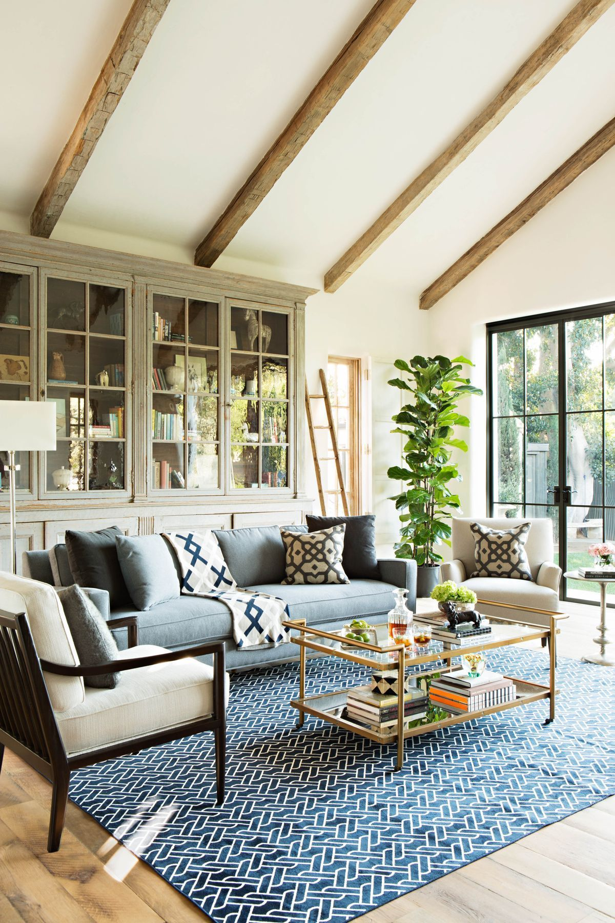 Exposed beams, a built-in glass-front cabinet, and large ...