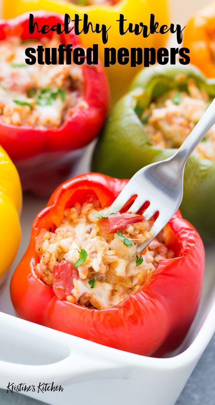 Stuffed bell peppers with rice, ground turkey or beef, tomato sauce and seasonings. These easy Italian stuffed peppers are a healthy meal that you can make ahead! Cook in the oven or in a crockpot.