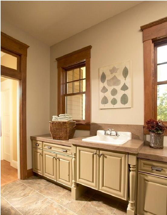 Kitchen with oak trim and cream cabinets … | Kitchen ...