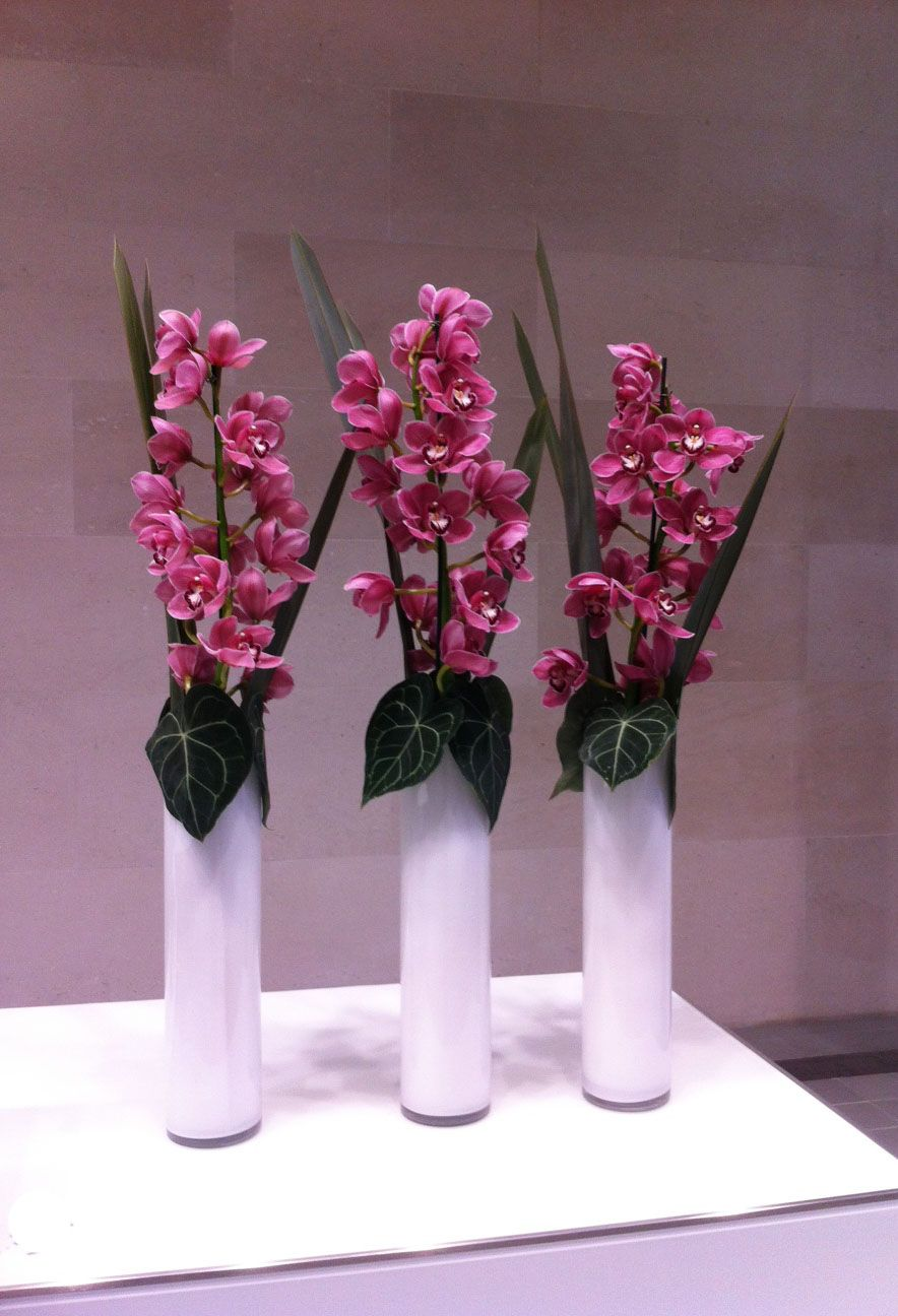 A cluster of three white vases for a reception desk with tall a cluster of three white vases for a reception desk with tall stems of cymbidium reviewsmspy