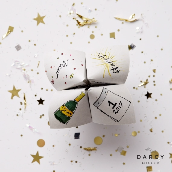 Printable New Year's Eve cootie catcher with free downloadable template and how-to | Darcy Miller Designs #NYE #celebrate #champagne #happynewyear #inspo #idea #artwork #drawing #sketch #original #markers #card #gift #activity #fortuneteller #partyfavor #easy #fun #newyearseve #new #years #eve #illustration