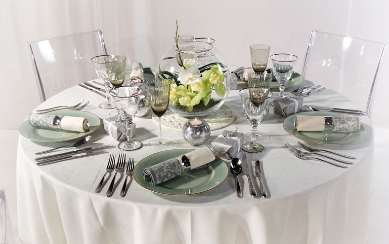 Clear Ghost Chairs combined with contemporary table setting and a fish bowl flower arrangement. Contemporary styles for 2013. & Clear Ghost Chairs combined with contemporary table setting and a ...