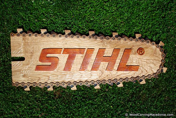 Stihl chain saw logo made through wood carving