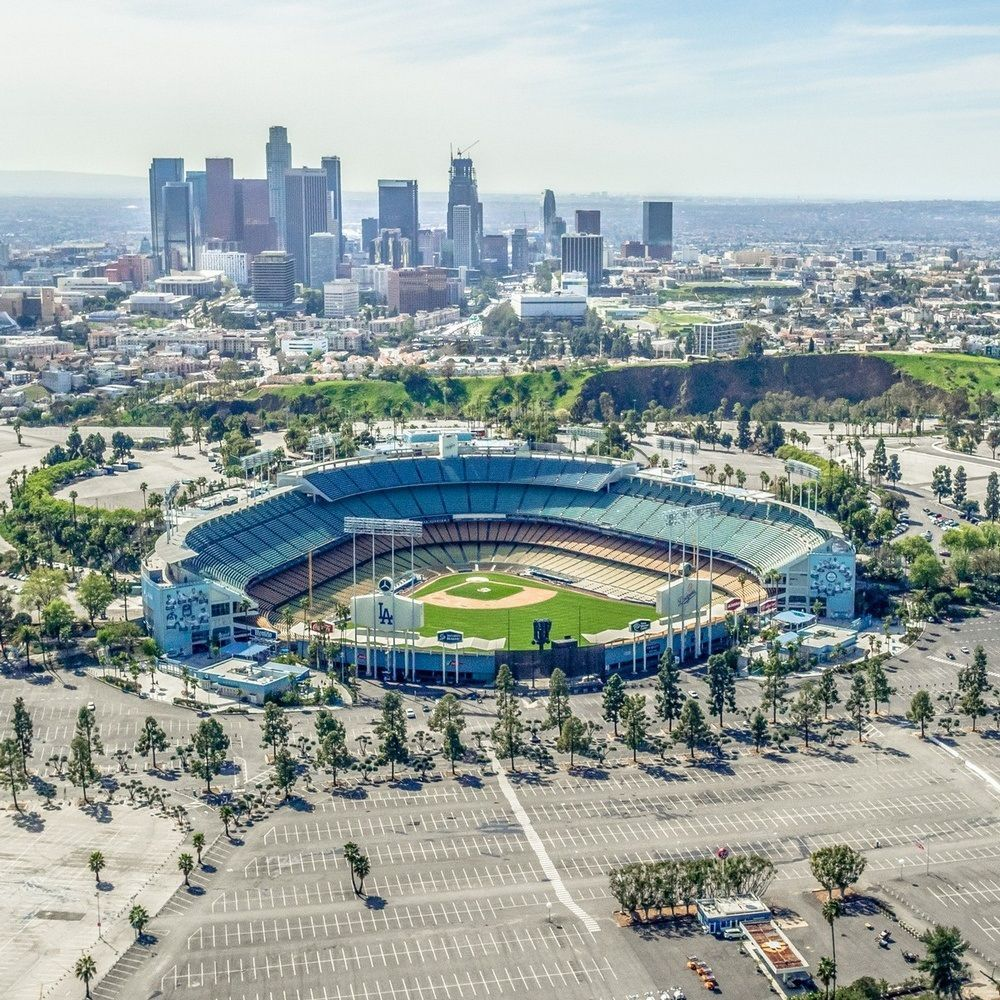 Aerial View Of The Dodgers Stadium With The Los Angeles Skyline In The Distance In 2020 Los Angeles Skyline Dodger Stadium Dodger Stadium Art