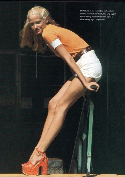 Model wearing hot pants and painted platforms, 1970s.