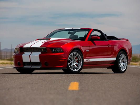 This Is A 2013 Ford Mustang Convertible In Red With White Stripes