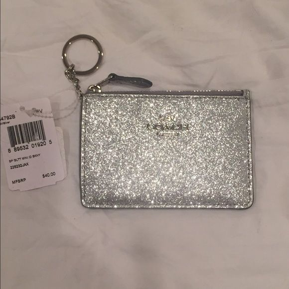 """NWT! Coach mini ID skinny in silver!  NWT! Authentic Coach mini ID skinny! Color is Glitter silver. Zip top closure and fabric lining. ID window with 2 credit card slots! Dimensions 4 1/2"""" X 3 1/2"""". Really pretty! I would love to keep it but I can't . Offers Welcomed!  Coach Bags Wallets"""
