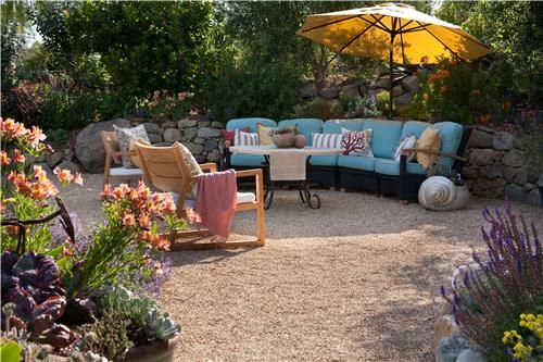 oversized outdoor furniture with colorful cushions provide an inviting spot to sit and relax description