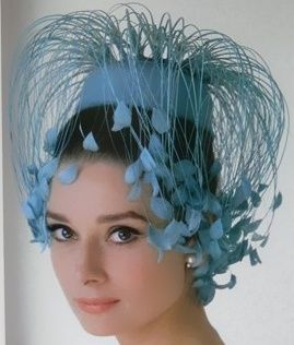 Audrey Hepburn in a blue pill box hat (with extras).