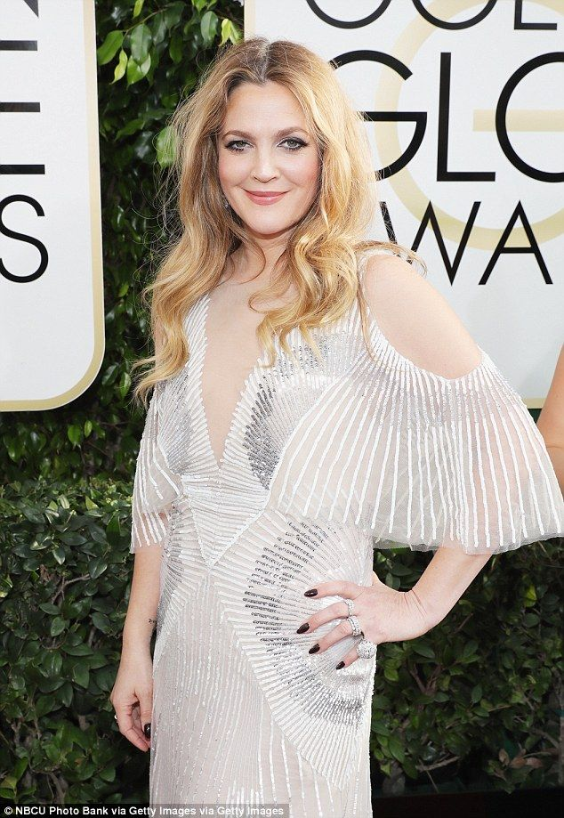 In all glory: She certainly dazzled when she hit the red carpet in a caped gown