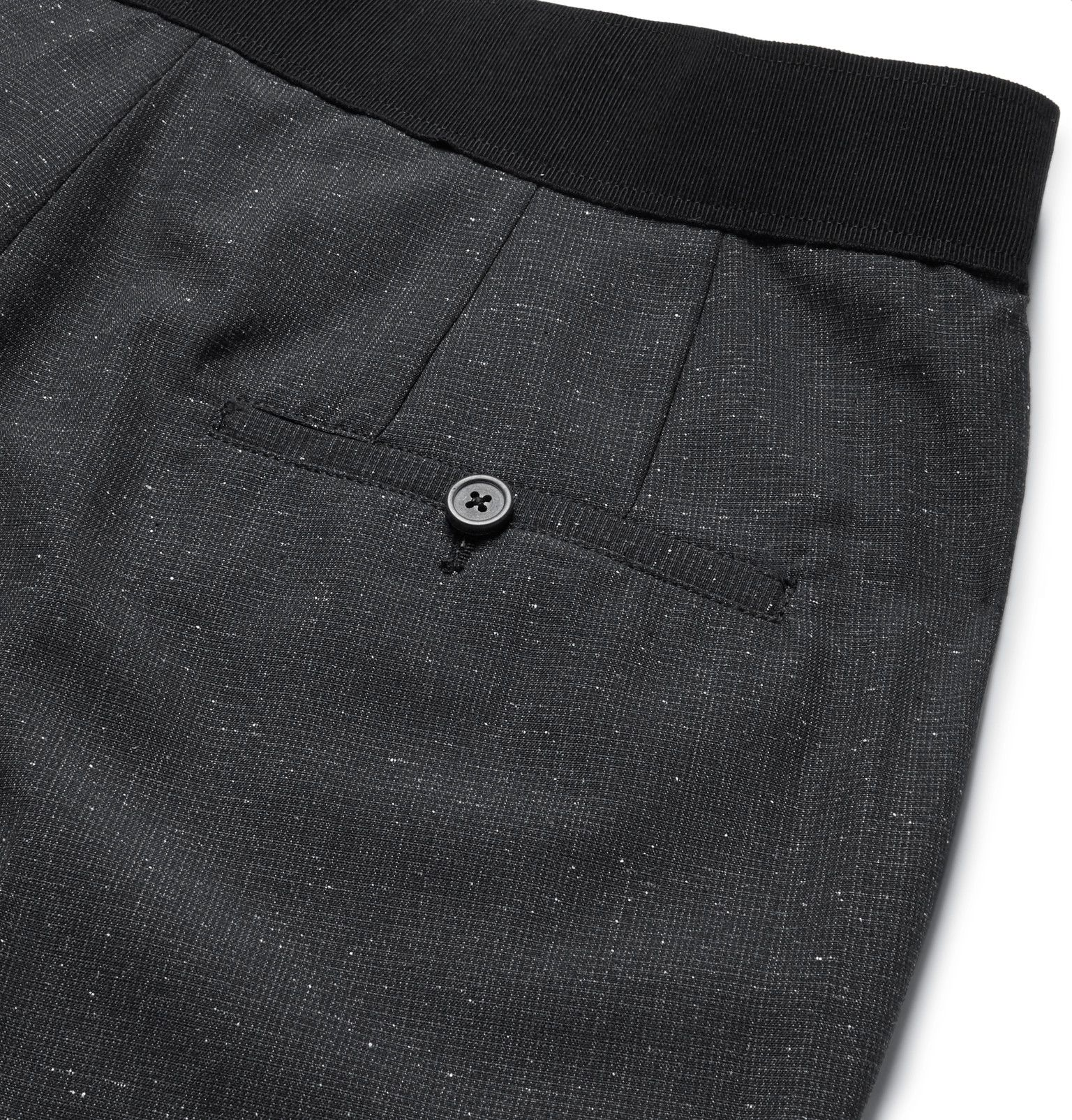 These <a href='http://www.mrporter.com/mens/Designers/Lanvin'>Lanvin</a> trousers exemplify the house's unmatched tailoring expertise. Designed in the most subtle puppytooth, they're crafted from a soft wool and silk-blend that's flecked with slubbed white threads. The elasticated waistband gives them the comfortable fit of sweats, while the neat slim cut and deep charcoal hue make them entirely smart.