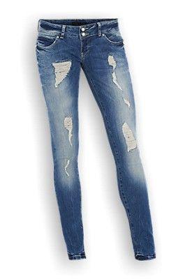 Medium washed skinny jeans met damaged plekken. De jeans