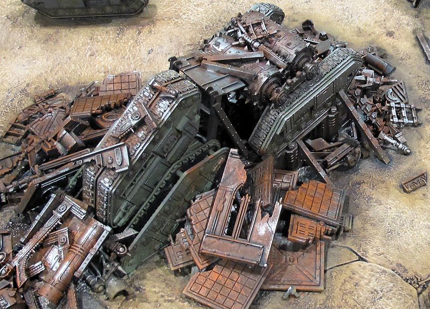 Orks are notoriously messy, pilling up heaps of rubbish where ever they are found until the whole planet is a squalid mess, lousy with greenskin spores. This piece of terrain uses scrap to recreate a processing plant at a tip.