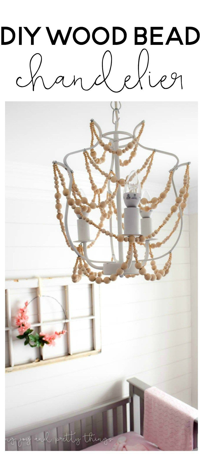 How to make a wood bead chandelier wood bead chandelier beaded easy diy to make a wood bead chandelier the perfect diy craft to add farmhouse aloadofball Gallery