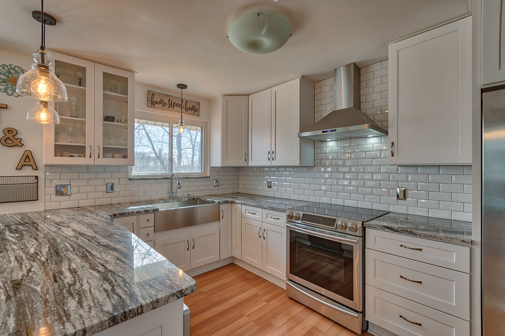 White Cabinets with Silver Cloud Granite Countertops ...