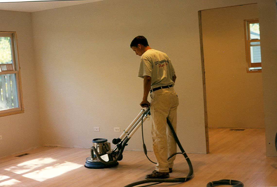 Pro Hardwood Refinishing Service Using Orbital Sander With